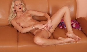 Blonde amateur seductress Leyla Tender plays with her glorious pussy on a sofa