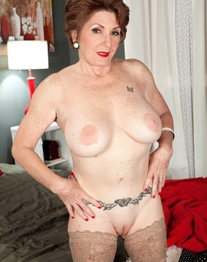 Mature vixen with short hair Bea Cummins strips off to show her nice pussy