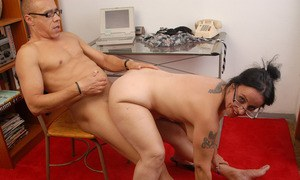 Older secretary in glasses Nina Swiss provides sexual services to her boss