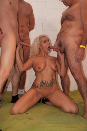 Experienced blonde lady takes on all cocks during a wicked gangbang scene