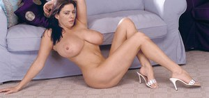 Hot brunette model Linsey Dawn McKenzie uncorks giant tits while getting nude