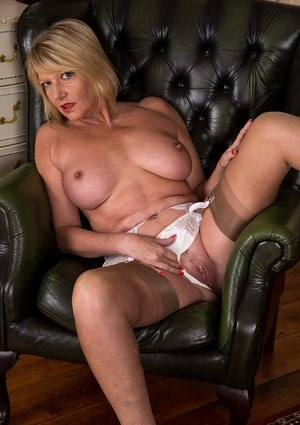 Hot older broad Amy Goodhead shows off her naked assets in tan nylons