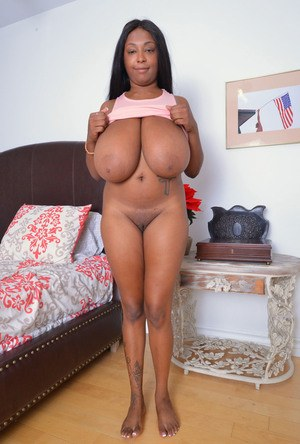 Amateur ebony babe with long dark hair shows her pink pussy and a butt