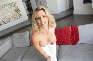 Blonde MILF Cory Chase gets naked on couch in teasing manner