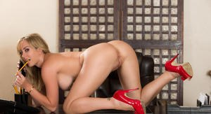 Hot blonde secretary Brett Rossi shows off her lusty nude body in red pumps