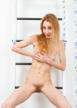 Aged redhead Kler peels off shorts and sexy undies to pet her all natural twat