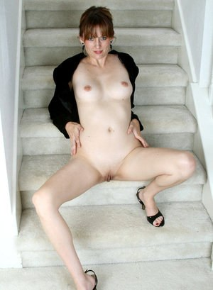 Classy mature lady Justine plays with her wide open pussy on staircase