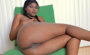 Hot black model Yara Skye gets naked and plays with her meaty labia lips