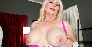 Experienced blonde lady Angelique DuBois teases her pierced nipples and pussy