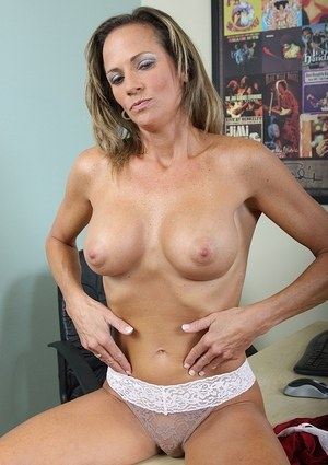 Clothed middle aged business lady Montana Skye prefers to be nude than dressed