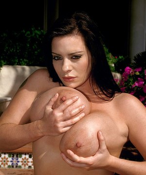 Big boobed solo model Linsey Dawn McKenzie plays with herself on outdoor steps