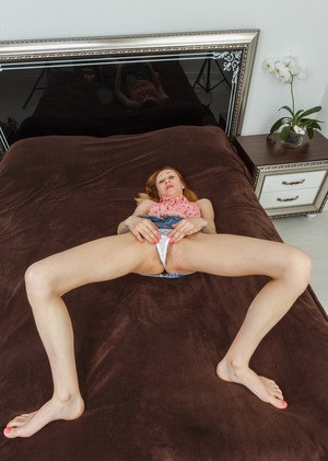 Aged woman with a skinny body reveals her hairy beaver showing her wet hole