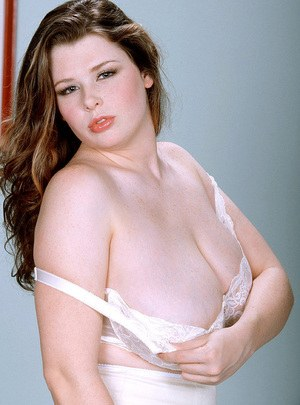 BBW pornstar Desirae reveals huge saggy tits while removing her 70's lingerie