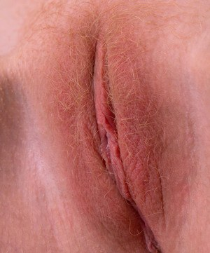 Amateur model Bambi delights in showing off her hot ass and hairy ginger pussy