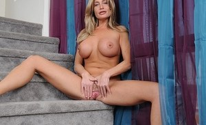 Blonde mommy Cindy uncovers big boobs after stripping off jeans and panties