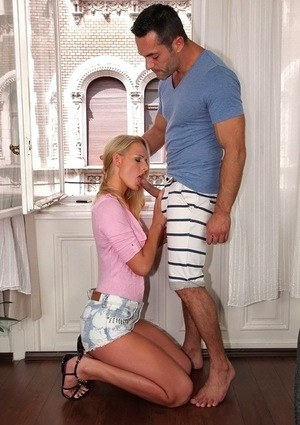 European blonde Chelsey Lanette drops to her knees to give oral sex