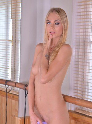 Fit blond girl Nancy A ends her workout by working over her pussy with sex toy