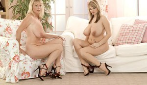 Chubby female Kelly Kay and her gf reveal huge tits while stripping together