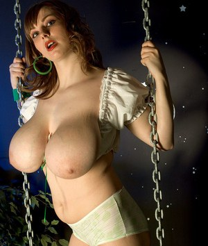 Solo girl Christy Marks exposes her knockers on swing before toying her pussy