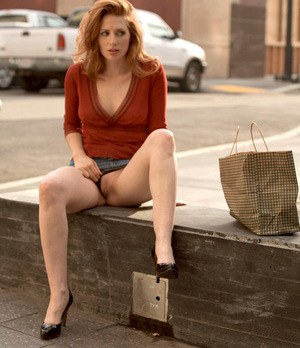 Redhead Amber hikes her skirt and flashes her panties and pussy on sidewalk
