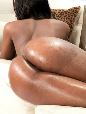 Ebony female Chanel Bryant releases her big booty from skirt and onesie