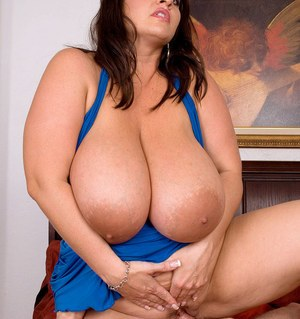Brunette BBW Maria Moore uses her massive tits to please her guy's cock