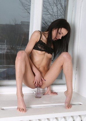 Skinny amateur Kate Sottile inserts a dildo into her dripping wet pussy