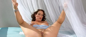 Housewife Sandy Beach reveals her ass and tits in slutty solo scenes