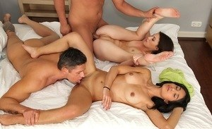 Top bitches sharing cock in the bedroom for a complete threesome