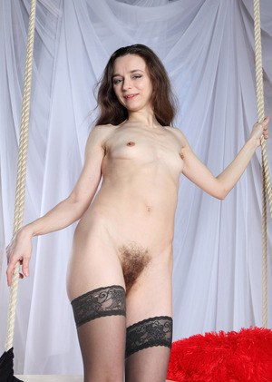 Middle aged woman Susanna tugs on her pubic hairs after undressing
