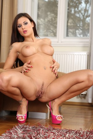 Leggy brunette Billie Star shows off her bare ass and pussy in pink high heels