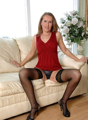 Older broad Sara James strips down to black stockings for a toying session