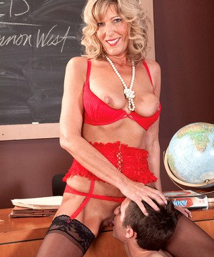 Older schoolteacher Shannon West seduces a young boy for sex in classroom