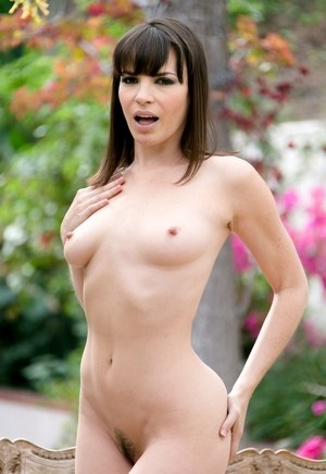 MILF Dana DeArmond models in the nude after removing bra and panties