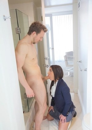 Young brunette Giselle Leon gives daddy figure a blowjob in her school uniform