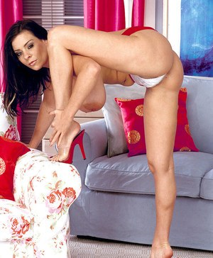 Busty Euro MILF Linsey Dawn McKenzie peels off red miniskirt to show her gush