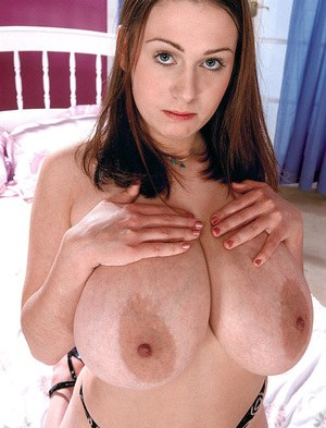 Solo model Nicole Peters shows off her huge tits and bush after removing skirt