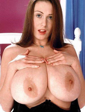 Amateur MILF Nicole Peters proudly shows off her massive all natural breasts