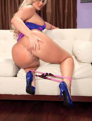 Thick blonde model Julie Cash flaunts her big white ass in high heeled shoes