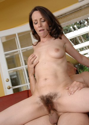Brunette amateur August spreads her hairy pussy wide open after a creampie