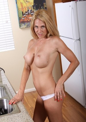 Blonde MILF Angela Attison uncovers big tits while stripping after dishwashing