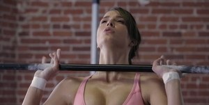 Fit female Malena Morgan frees firm tits from sports bra after sweaty workout