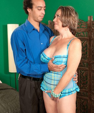 Chubby aged divorcee Lydia South welcomes her Latino gigolo for a night of sex