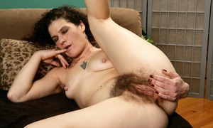 Older solo model Sunshine shows how hard her nipples get while showing beaver