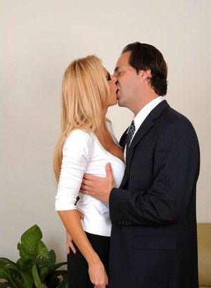Older secretary Brooke Tyler greets her boss with a kiss and BJ in short skirt