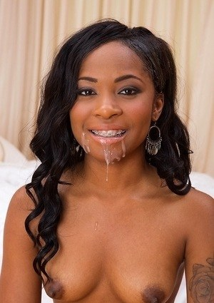Beautiful black girl Toni Marie takes a load of sperm in open mouth after sex
