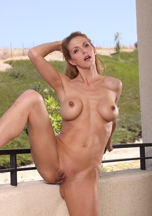 Mature Roxanne Hall feels like touching her shaved peach in slow motion