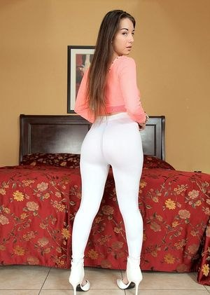 Latina female in see thru top and yoga pants unveils her juicy ass
