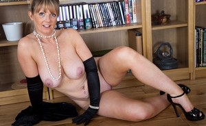 Classy lady flaunts her nice mature tits and ass wearing long black gloves