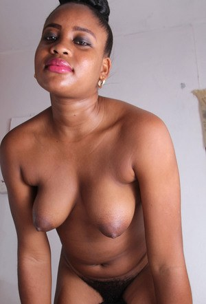 African amateur Amber spreads her hairy pussy in hopes of earning Green Card